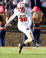 Oct. 22, 2011 - Charlottesville, Virginia - USA; North Carolina State kicker Niklas Sade (32) kicks the ball during an NCAA football game against the Virginia Cavaliers at the Scott Stadium. NC State defeated Virginia 28-14. (Credit Image: © Andrew Shurtleff