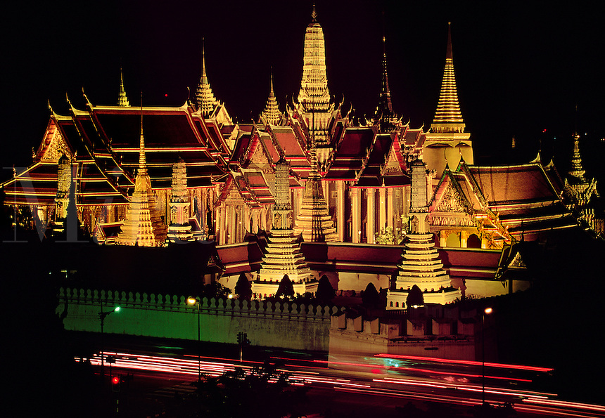 Wat Phra Kaeo and the Grand Palace illuminated at night Bangkok Thailand.