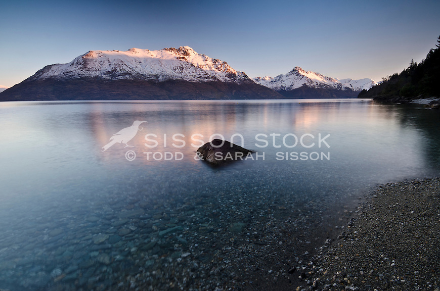 Last light at sunset on Walter and Cecil Peaks, Lake Wakatipu, Queenstown, South Island, New Zealand