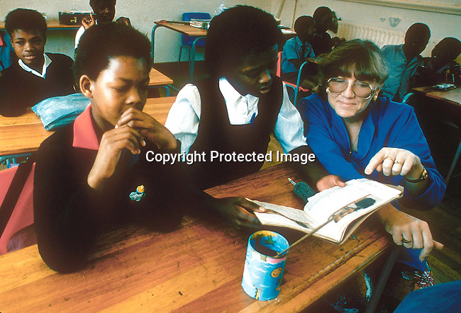 EDSECON19053.Education.  Secondary.  Ventersdorp.  Black school children in a classroom.  White female teacher. The school was only for white students in the Apartheid era, but now theres only a few white pupils.  95..©Per-Anders Pettersson / iAfrika Photos