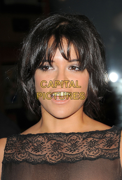 "MICHELLE RODRIGUEZ.World Premiere of ""Fast & Furious"" held at Gibson Ampitheatre in Universal City, California, USA. .March 12th, 2009                                                                     headshot portrait mouth open black lace .CAP/DVS.©Debbie VanStory/Capital Pictures."