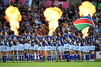 The Namibia team line up for the national anthems. Rugby World Cup Pool C match between Tonga and Namibia on September 29, 2015 at Sandy Park in Exeter, England. Photo by: Patrick Khachfe / Onside Images