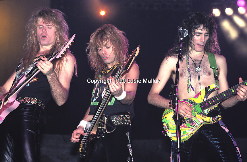 Adrian Vandenberg, Rudy Sarzo, and Steve Vai of Whitesnake performs UNO in New Orleans Louisiana, USA