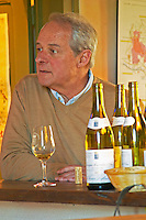 Patrick Leflaive, co-owner of Olivier Leflaive Freres in Puligny-Montrachet at their restaurant La Table d'Olivier, glass of Meursault, cork and bottles