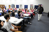 NWA Democrat-Gazette/ J.T. WAMPLER -- Former University of Arkansas basketball coach Nolan Richardson speaks to Central Junior High School basketball players Thursday Feb. 12, 2015.