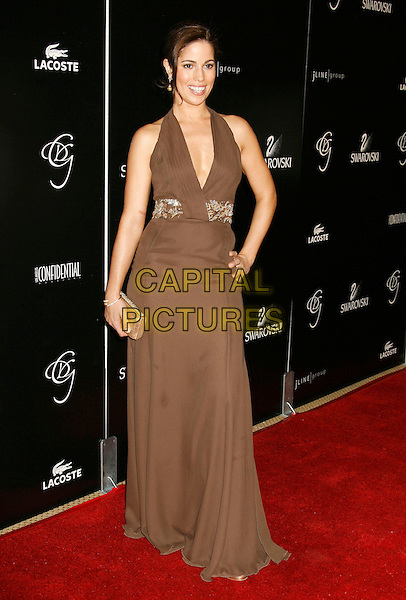 ANA ORTIZ.2007 Costume Designers Guild Awards held at the Beverly Wilshire Hotel, Beverly Hills, California, USA,.17 February 2007..full length brown halterneck dress hand on hip.CAP/ADM/RE.©Russ Elliot/AdMedia/Capital Pictures.