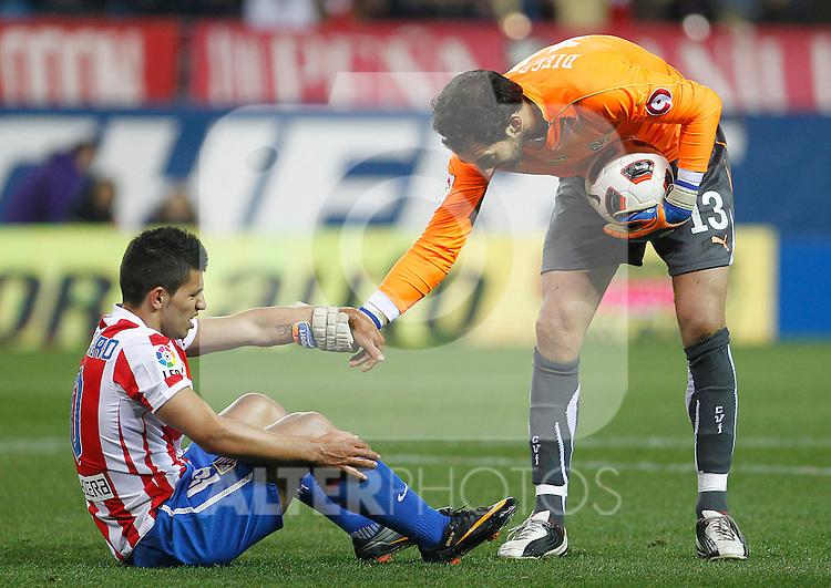 Atletico de Madrid's Kun Aguero (l) and Villareal's Diego Lopez during La Liga match.March 5,2011. (ALTERPHOTOS/Acero)