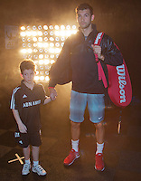 11-02-14, Netherlands,Rotterdam,Ahoy, ABNAMROWTT, Grigor Dimitrov(BUL) walk on court with an escort<br /> Photo:Tennisimages/Henk Koster