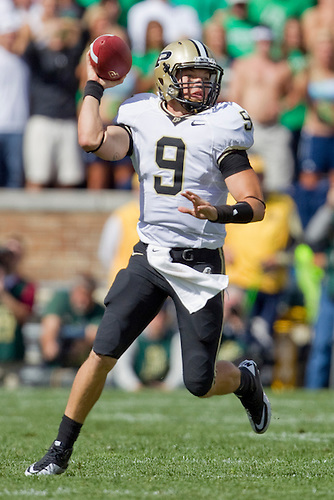 Purdue quarterback Robert Marve (#9) looks to pass in game action during NCAA football game between the Notre Dame Fighting Irish and the Purdue Boilermakers.  Notre Dame defeated Purdue 23-12 in game at Notre Dame Stadium in South Bend, Indiana.