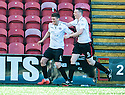 Clyde's David Marsh (6) celebrates with Brian McQueen (9) after he scores their second goal.