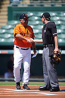 GCL Orioles manager Orlando Gomez (23) shakes hands with umpire Ross Sheridan during the lineup exchange before a game against the GCL Twins on August 11, 2016 at the Ed Smith Stadium in Sarasota, Florida.  GCL Twins defeated GCL Orioles 4-3.  (Mike Janes/Four Seam Images)