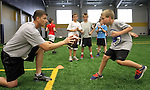 SIOUX FALLS, SD - JULY 2:  Josh Siegfried, left, runs a defensive drill with Finley Ziebarth at the Riggs Football Academy Tuesday night at the Sanford Fieldhouse. (Photo by Dave Eggen/Inertia)
