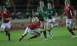 Wales scrum half Rhodri Williams stops his opposite number Luke McGrath..Under 20 Six Nations.Wales v Ireland.Eirias - Colwyn Bay.01.02.13.©Steve Pope