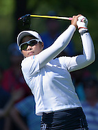 Owings Mills, MD - July 26, 2014: Pornanong Phatlum, of Team Thailand, tees off on the 10th hole during Round 3 of four-ball competition at the LPGA International Crown at the Caves Valley Golf Club in Owings Mills, MD on July 26, 2014. 32 players from twelve countries competed in this inaugural tournament.  (Photo by Don Baxter/Media Images International)