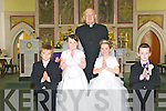 Pupils Sean Galvin, Zoe Dickenson, Ava Fitzgerald and Mark Dickenson from Dromerin NS who made their First Holy Communion in St Teresas Church, Ballydonoghue, on Saturday, pictured here with Fr John Lawlor.