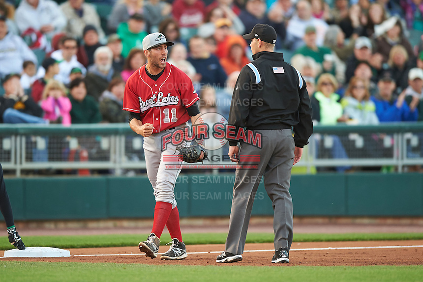 Great Lakes Loons third baseman Mike Ahmed (11) argues a call with umpire Brock Ballou during a game against the Dayton Dragons on May 21, 2015 at Fifth Third Field in Dayton, Ohio.  Great Lakes defeated Dayton 4-3.  (Mike Janes/Four Seam Images)