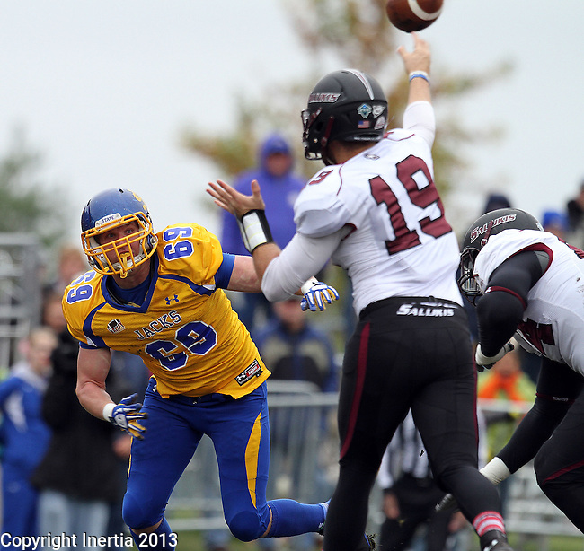 BROOKINGS, SD - OCTOBER 5:  Marshall Peugh #69 from South Dakota State University pressures quarterback Kory Faulkner #19 from Southern Illinois in the first quarter Saturday afternoon at Coughlin Alumni Stadium in Brookings. (Photo by Dave Eggen/Inertia)