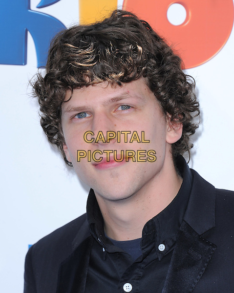 "JESSE EISENBERG .at The Twentieth Century Fox and Blue Sky Studios L.A. Premiere of ""RIO"" held at The Grauman's Chinese Theatre in Los Angeles, California, USA, .April 10th 2011..portrait headshot  black shirt .CAP/RKE/DVS.©DVS/RockinExposures/Capital Pictures."