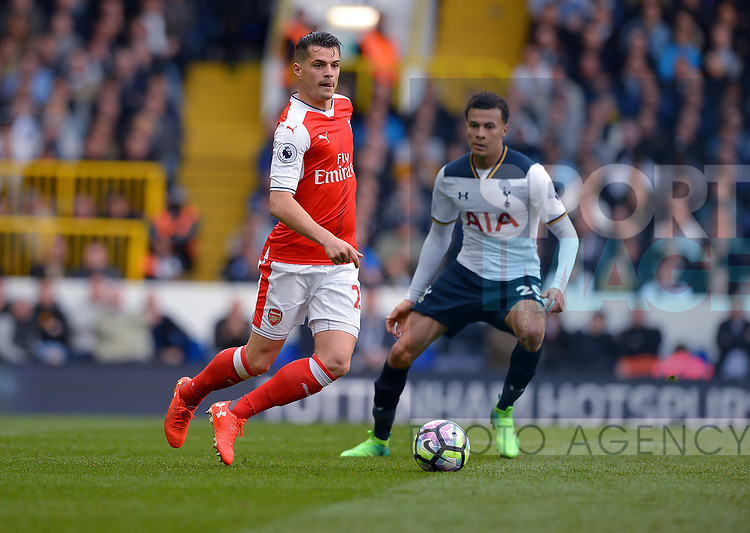 Granit Xhaka of Arsenal is challenged by Dele Alli of Tottenham Hotspur during the English Premier League match at the White Hart Lane Stadium, London. Picture date: April 30th, 2017.Pic credit should read: Robin Parker/Sportimage