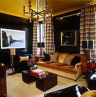 The library is strikingly decorated with black panelled walls and a yellow ceiling set off by black and yellow striped curtains