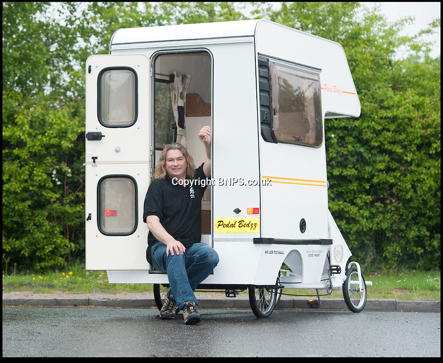 BNPS.co.uk (01202) 558833.Picture: Peter Willows..It might only have 4ft of living space but this mini mobile home comes with everything a camper would want including a cooker, a sink, a table and a bed. The 'cramper van' is thought to be the smallest camper van in the world. Creative mechanic Andy Saunders chopped 6ft off the front of a Bedford Bambi campervan and attached it to a Butlins pedal cart before fitting the bespoke interior.