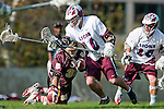 Los Angeles, CA 03/08/10 - Dennis McSweeney (FSU # 38), Travis Abraham (LMU # 10) and Greg Sharron (LMU # 18) in action during the Florida State-LMU MCLA interconference men's lacrosse game at Leavey Field (LMU).  Florida State defeated LMU 12-7.