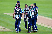 PICTURE BY ALEX WHITEHEAD/SWPIX.COM - Cricket - Clydesdale Bank 40 - Yorkshire v Warwickshire - North Marine Road Ground, Scarborough, England - 27/08/12 - Yorkshire's Adil Rashid (centre) celebrates the wicket of Warwickshire's William Porterfield with team-mates.