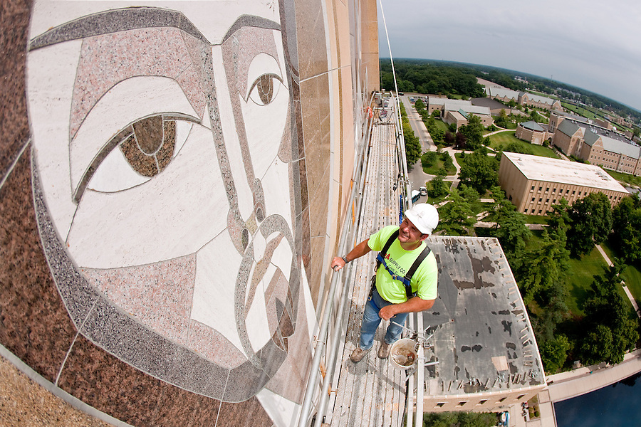 Jul.28. 2011; Clint Goble of Ziolkowski Construction looks over the restoration and repair work done on the Word of Life mural on Hesburgh Library during the summer of 2011...Photo by Matt Cashore/University  of Notre Dame