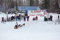 Dakota Schlosser runs to the finish line of the 2016 Junior Iditarod in Willow, Alaska, AK  February 28, 2016