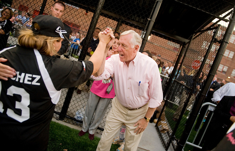 UNITED STATES - JUNE 23:  House Minority Whip Steny Hoyer, D-Md., greets Rep. Linda Sanchez, D-Calif., during the third annual Congressional Women's Softball game held at Watkins Recreation Center on Capitol Hill.  The charity match, which pits female members of Congress against female D.C. journalists, was won by the members 5-4.  Proceeds from the event help fund the Young Survival Coalition, a breast cancer support organization. (Photo By Tom Williams/Roll Call)