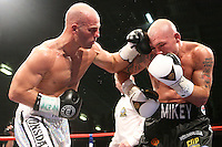 Ryan Rhodes (white shorts) defeats Jamie Moore in a Light-Middleweight Boxing contest for the European EBU Title at the Bolton Arena, promoted by Frank Maloney - 23/10/09 -