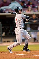Tony Delmonico #7 of the Great Lakes Loons follows through on his swing versus the Dayton Dragons at Fifth Third Field April 21, 2009 in Dayton, Ohio. (Photo by Brian Westerholt / Four Seam Images)