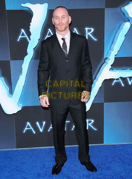 MATT GERALD .The Twentieth Century Fox World Premiere of Avatar held at The Grauman's Chinese Theatre in Hollywood, California, USA. .December 16th, 2009.full length black suit.CAP/RKE/DVS.©DVS/RockinExposures/Capital Pictures.