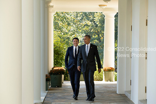 US President Barack Obama (R) and Italian Prime Minister Matteo Renzi (L) walk down the Colonnade to hold a joint news conference in the Rose Garden of the White House, in Washington DC, USA, 18 October 2016. Later today President Obama and First Lady Michelle Obama will host their final state dinner featuring celebrity chef Mario Batali and singer Gwen Stefani performing after dinner. <br /> Credit: Michael Reynolds / Pool via CNP