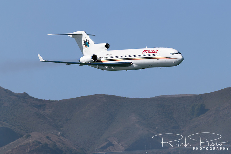 The San Jose Sharks Hockey Team's aircraft, a Boeing 727 (N724YS)  makes a low pass over San Francisco Bay