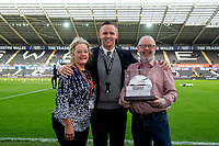 Lee Trundle with the match ball sponsors during the Sky Bet Championship match between Swansea City and Derby County at the Liberty Stadium in Swansea, Wales, UK. Saturday 08 February 2020