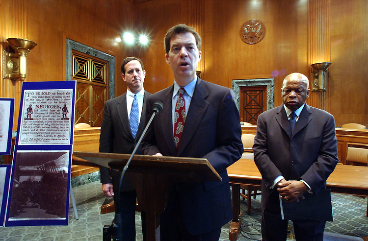 African10_052103 --  Rick Santorum, R-Pa., Sam Brownback, R-Kan., and John Lewis, D-GA., during a  news conference to unveil legislation authorizing the c of African American History and Culture.