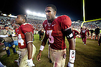 TALLAHASSEE, FL 11/19/11-FSU-UVA111911 CH-Florida State's quarterback EJ Manuel, right and Terrance Smith walk off the field after the Seminoles lost to Virginia's 14-13 Saturday at Doak Campbell Stadium in Tallahassee. COLIN HACKLEY PHOTO