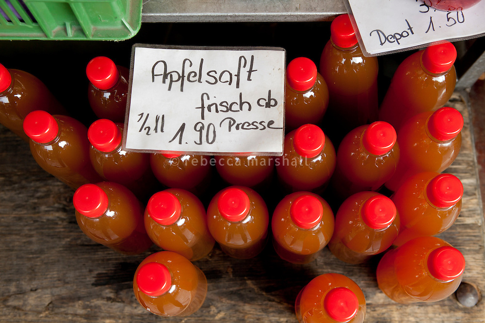 Bottles of fresh apple juice on sale at the Saturday market in Bundeshausplatz, Bern, Switzerland, 27 August 2011