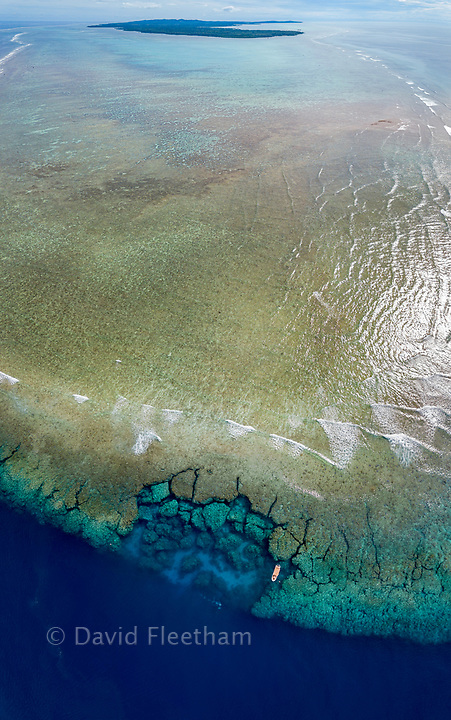 An aerial view of the southern end of the reef surrounding the island of Yap, Micronesia. One dive boat is anchored at Yap Cavern's, a famous site for scuba divers.