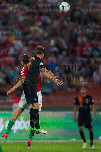 Netherlands' KIaas Jan Huntelaar (front) jumps for a header during a World Cup 2014 qualifying soccer match Hungary playing against Netherlands in Budapest, Hungary on September 11, 2012. ATTILA VOLGYI