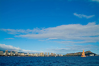 Wide angled shot of the Waikiki coastline from downtown Honolulu to Diamond Head shot from a sailboat off Waikiki.