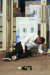 © Joel Goodman - 07973 332324 . No syndication permitted . 01/01/2014 . Manchester , UK . A man lies collapsed in a doorway besides a bottle of Champagne on Withy Grove in Manchester . Revellers see in the New Year in Manchester today (January 1st 2014) as police report that officers are at full stretch responding to calls . Photo credit : Joel Goodman