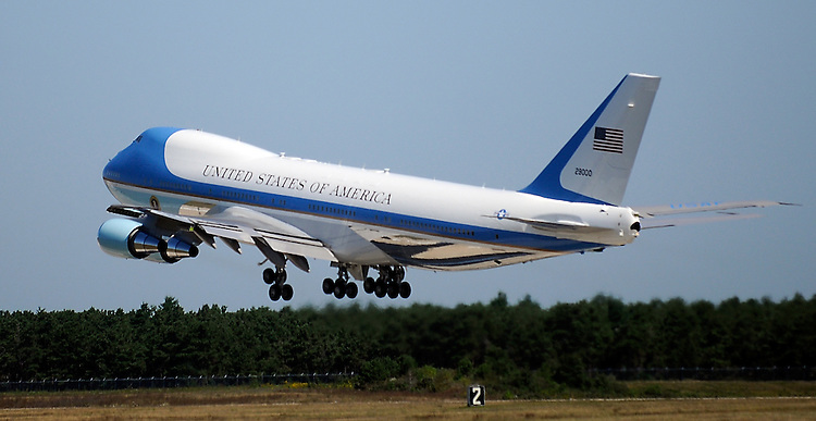 (082910, Bourne, MA) Air Force One with President Barack Obama aboard departs the Cape Cod Coast Guard Air Station in Bourneat  Sunday, August 29, 2010. Photo by Christopher Evans
