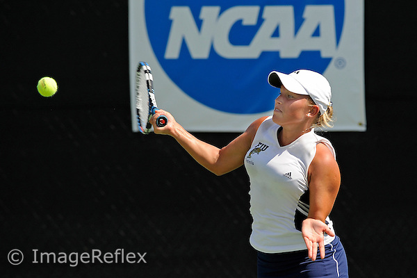 9 May 2009:  FIU's Maria Spenceley returns the ball during FIU's match against Miami during the second round of the NCAA 2009 Tennis Championships (Coral Gables Regional) at the Neil Schiff Tennis Center in Coral Gables, Florida.
