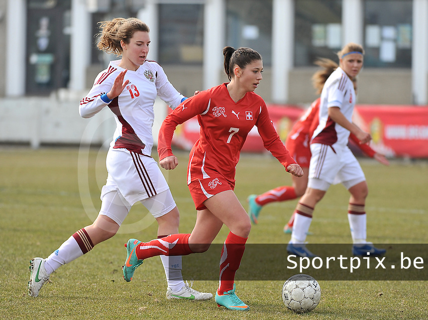 Switzerland U19 - Russia U19 : Carmen Pulver with the ball  before .Anastasia Shevchenko (left).foto DAVID CATRY / Nikonpro.be