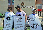 Washington Redskins players walk the picket line outside Redskins Park in Herndon, Virginia on September 22, 1987, the first day of the NFL players strike.<br />