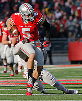 Ohio State Buckeyes tight end Jeff Heuerman (05) gains yards in the fourth quarter of their game at Ohio Stadium in Columbus, Ohio on November 22, 2014. (Columbus Dispatch photo by Brooke LaValley)
