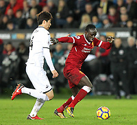 Sadio Mane of Liverpool & Ki Sung-Yueng of Swansea City during the Premier League match between Swansea City and Liverpool at the Liberty Stadium, Swansea, Wales on 22 January 2018. Photo by Mark Hawkins / PRiME Media Images.