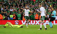 Referee Damin Skomina (R) shows a yellow card to David Meyler of Ireland (C) for his foul against Wayne Hennesey of Wales (L) during the FIFA World Cup Qualifier Group D match between Wales and Republic of Ireland at The Cardiff City Stadium, Wales, UK. Monday 09 October 2017